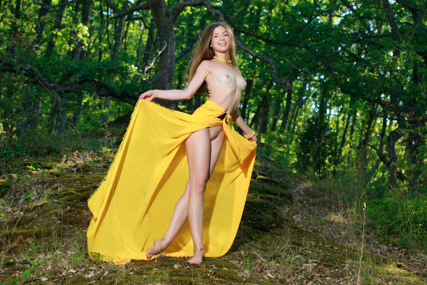 Yellow dress and necklace brunette posing completely naked in the forest