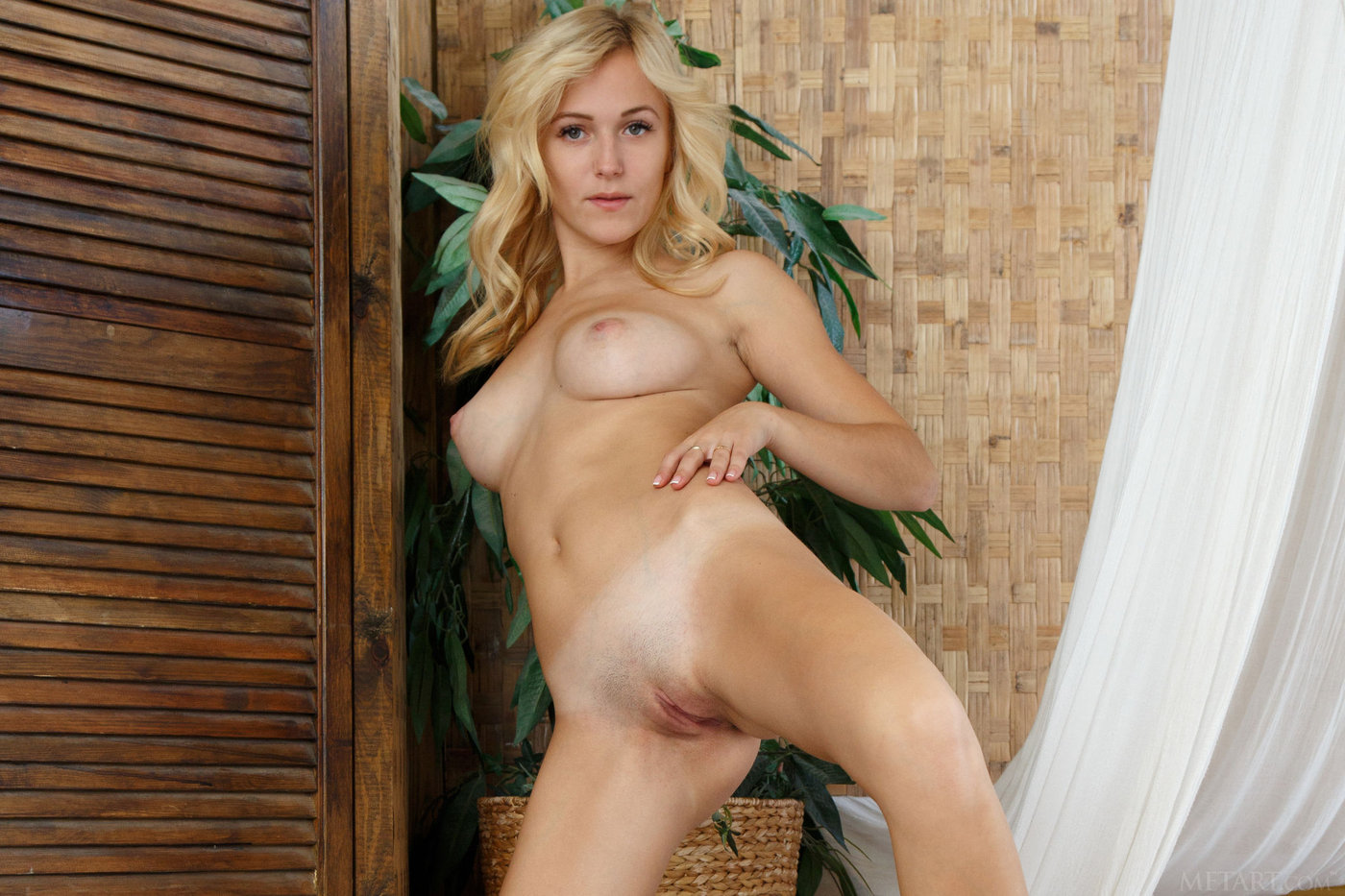 Wavy-haired blonde just woke up, she's ready to get naked and masturbate