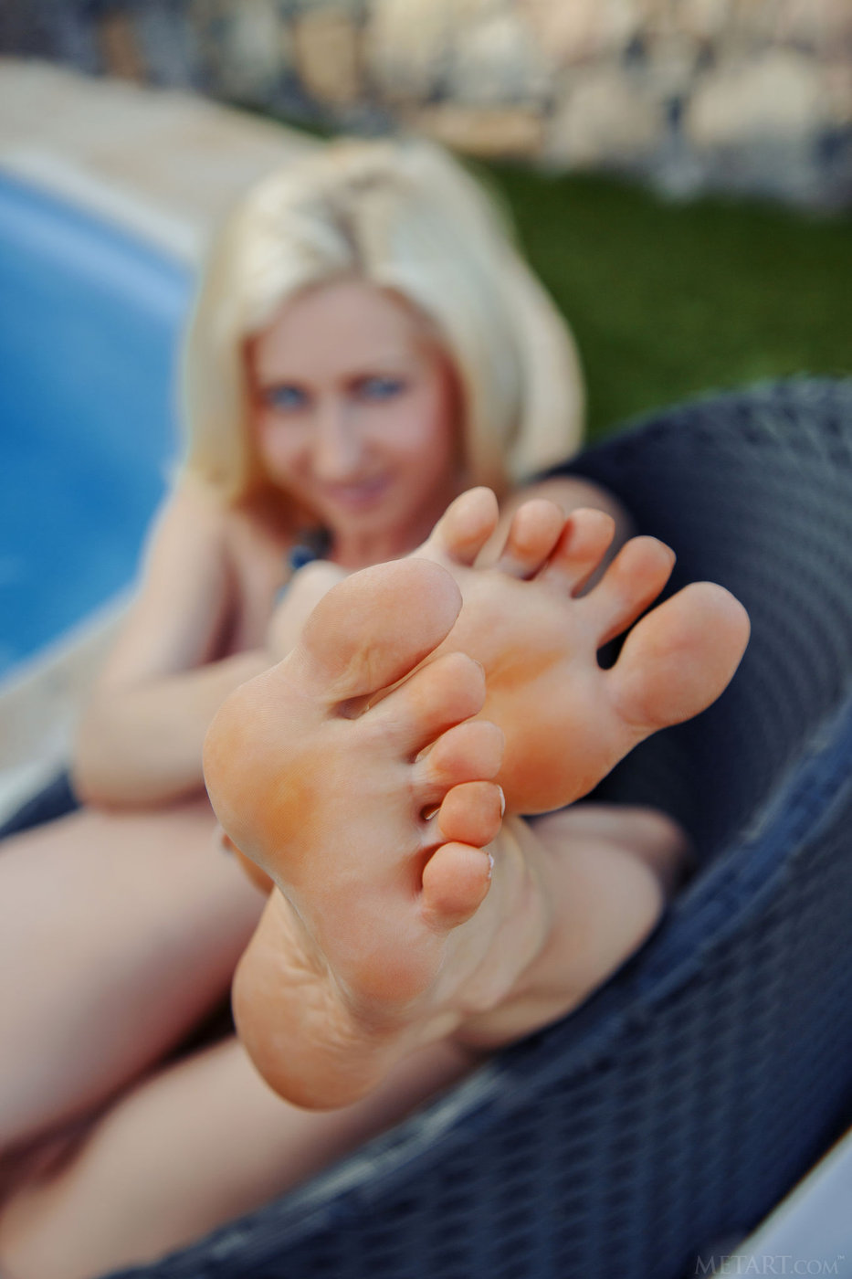 Blonde with blue eyes shows her perfect feet and trimmed pussy
