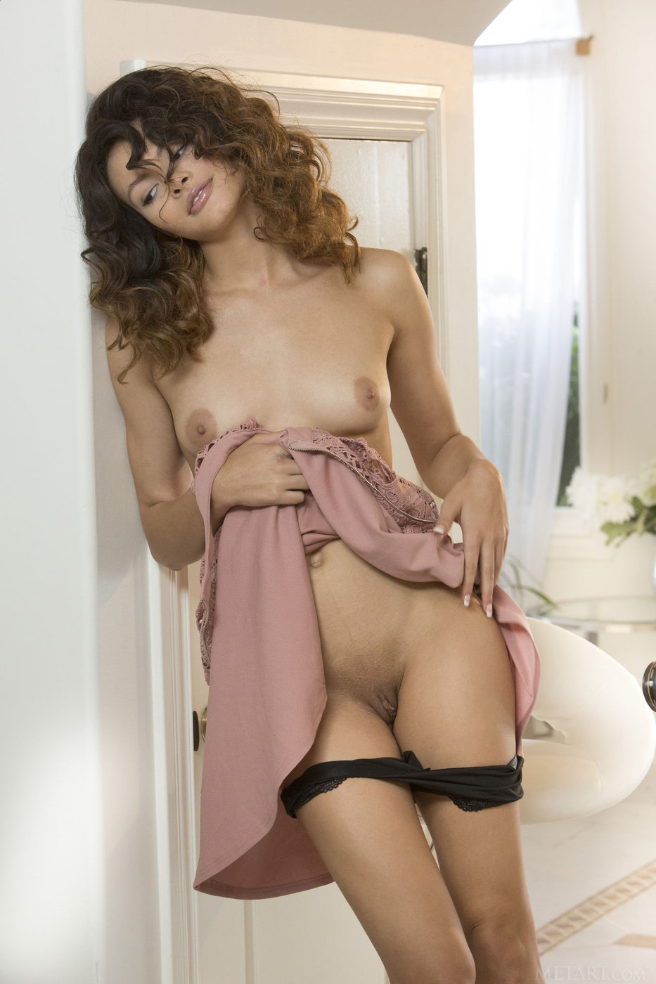 Curly-haired Native American brunette shows her amazing pussy