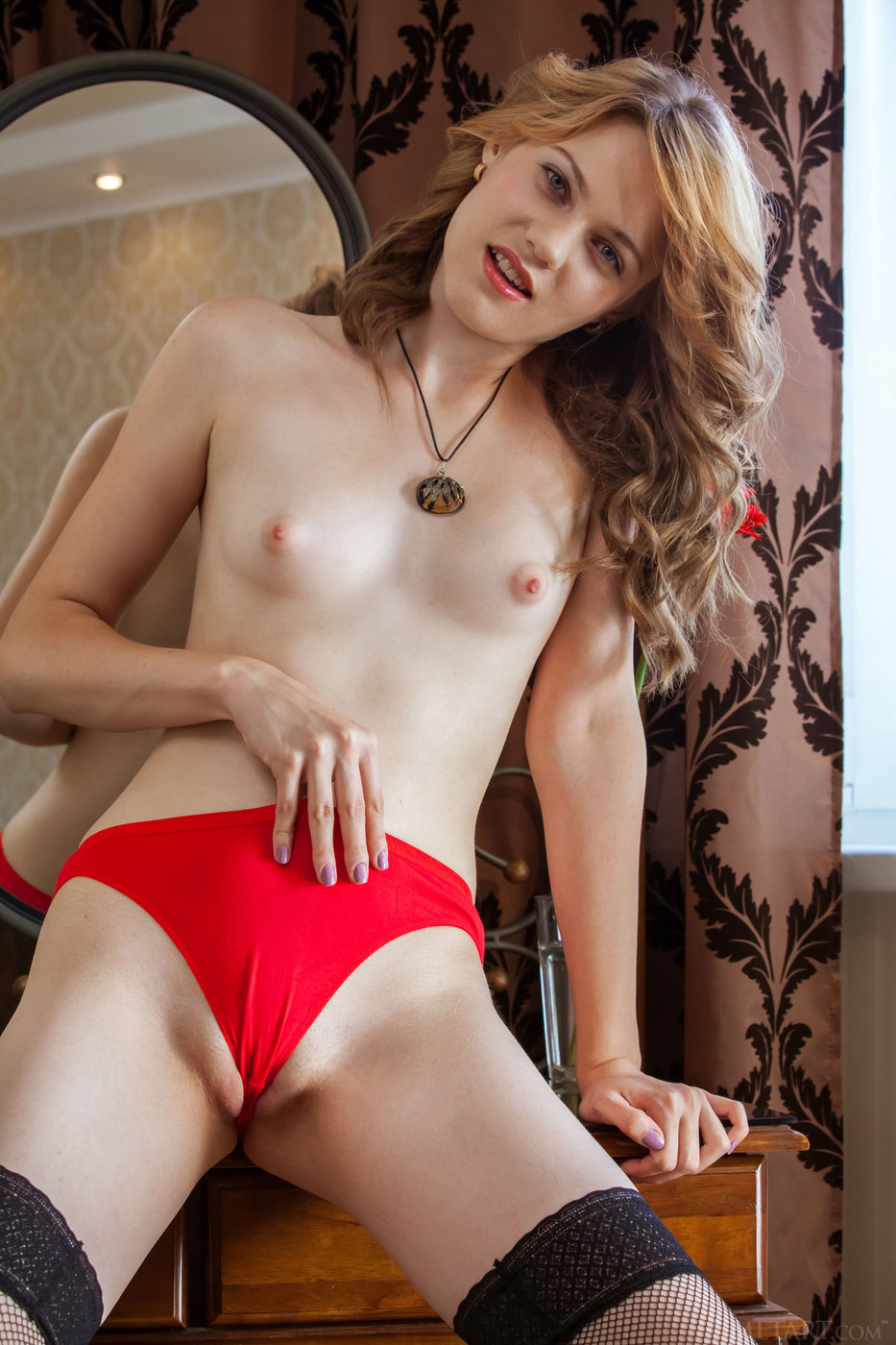 Wavy-haired blonde in red panties showing off her beautiful pussy