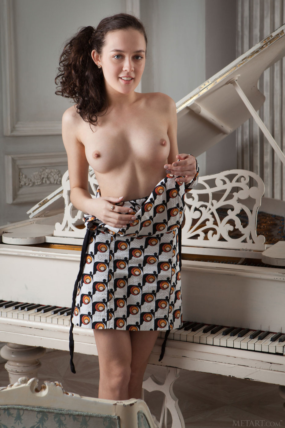 Curly-haired brunette takes off her dress to show her bushy pussy