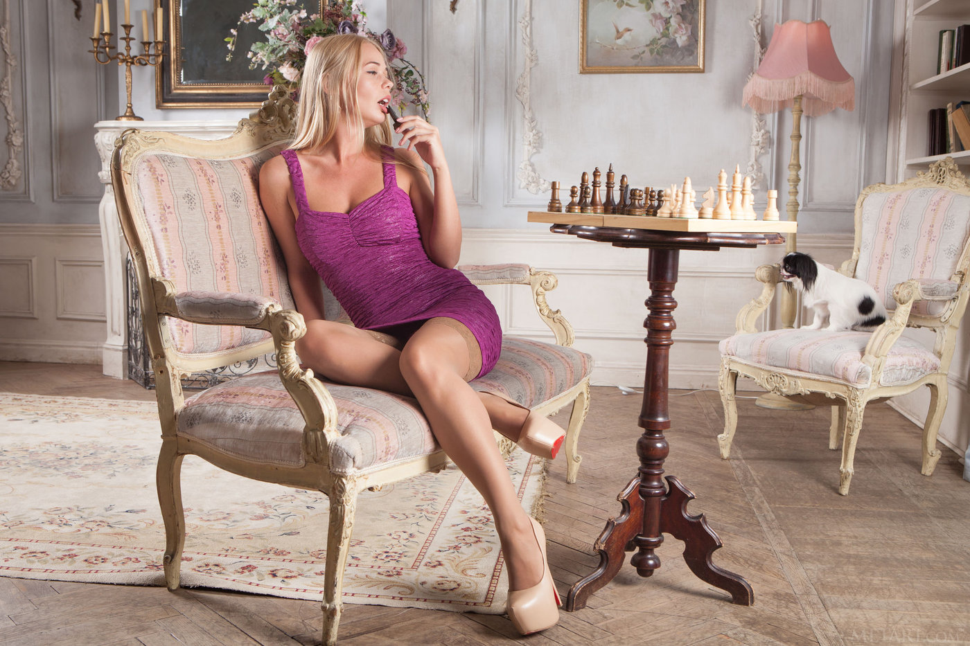 Blond-haired chick gets really bored with chess and starts getting naked