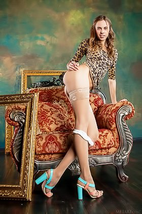 Pigtailed brunette takes off her leopard-y get-up to pose with her legs up Videos