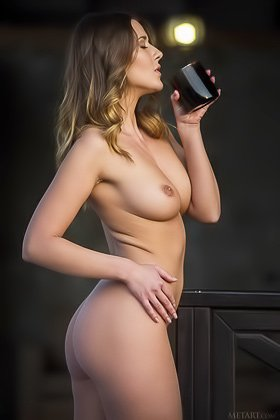 Beautiful-looking brunette with flowing locks gets naked on a porch Videos