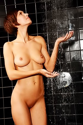 Short-haired and slightly mannish brunette gets naked in the shower Videos