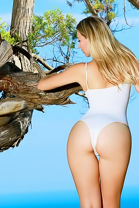 Long-legged blonde takes off her white bathing suit and climbs a tree Videos