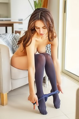 Sexy stockings brunette shows her immaculate pussy to the viewer Videos