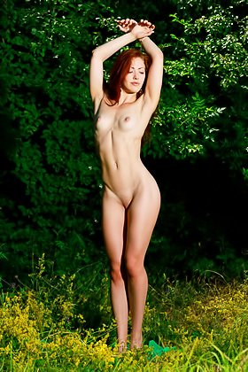 Blue-eyed redhead in blue lingerie posing naked with her ass on the grass Videos