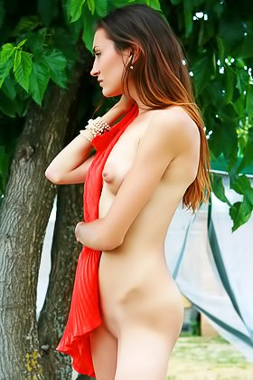 Brunette beauty takes off her red retro-style dress outdoors Videos
