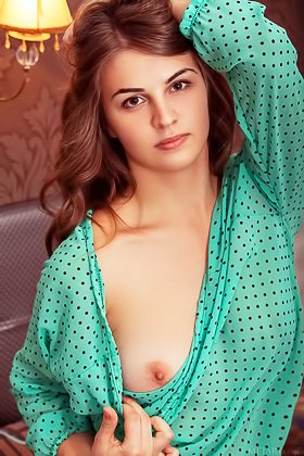 Long-haired seductress takes off her green/baggy/transparent blouse Videos