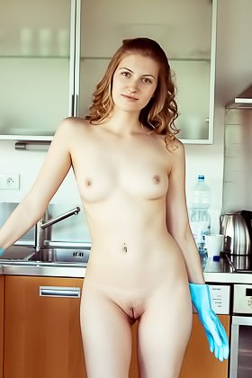 Striped get-up curly-haired hottie decides to undress in the kitchen Videos