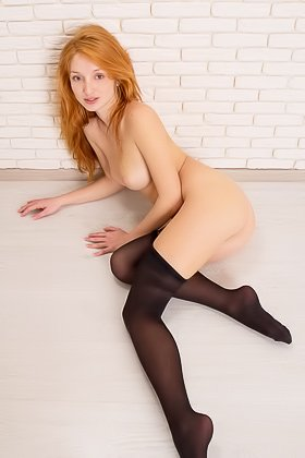 Pale-looking redheaded seductress takes off her black pantyhose Videos