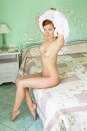 Braided redhead with blue eyes sensually posing and undressing Videos