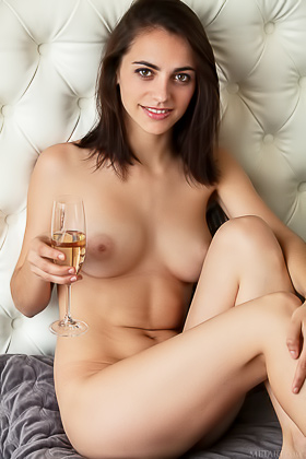 Boozed-up dark-haired seductress shows her pretty pussy on a bed Videos