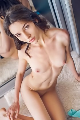 Teenage seductress takes off her blue get-up in front of the mirror Videos