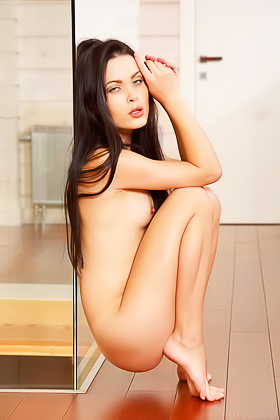 Bitchy-looking brunette takes off her dress to pose naked on the floor Videos