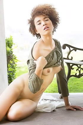 Curly-haired ebony beauty in cool shades shows her pussy outdoors Videos