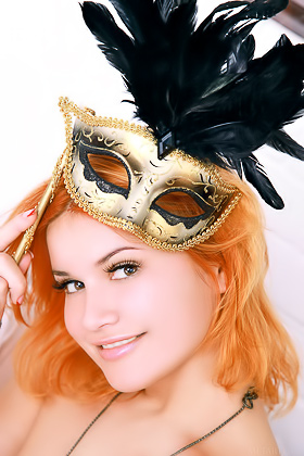 Redhead takes off her carnival mask along with the rest of her outfit Videos