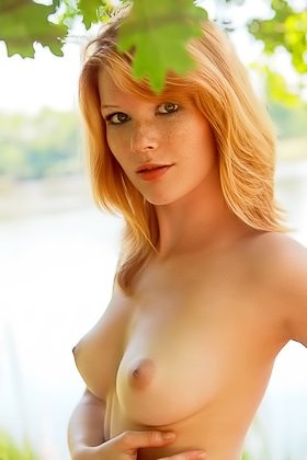 Redheaded cutie exposes her perfect pussy next to some river Videos