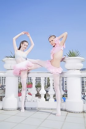 Two ballerina beauties flashing their pussies while posing together Videos