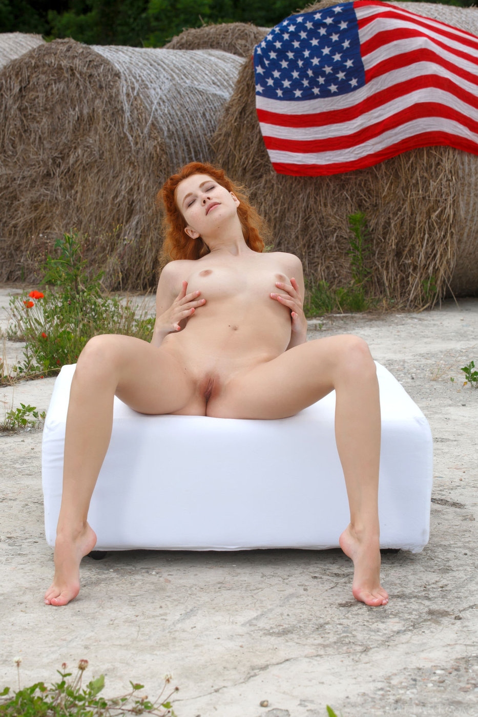 curly haired redhead outdoors