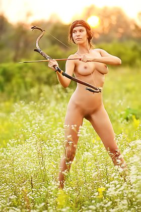 Busty and curvy brunette archer practicing her skills naked outdoors Videos