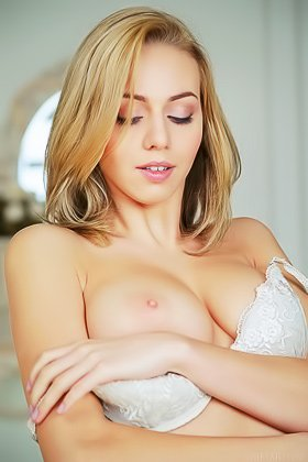 Irresistible blonde with blue eyes taking off her grey lingerie Videos
