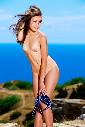 Long-haired and long-legged brunette beauty posing nude by the sea Videos