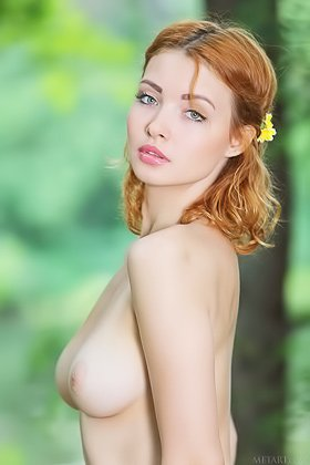 Redhead with blue eyes shows her beautiful boobs in the forest Videos