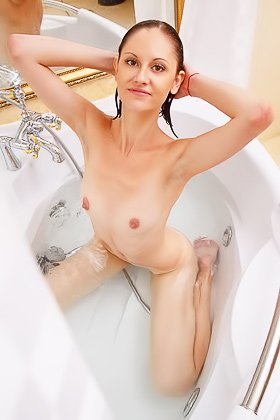 Dark-haired hottie with tiny breasts showing off in the bathroom Videos