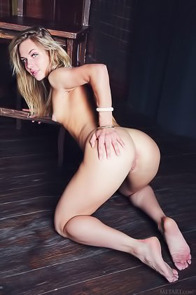 Toned blonde takes off her leopardy blouse and poses naked on a chair Videos