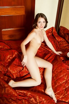 Flat-chested brunette gets on all fours on a huge pink bed in HQ Videos