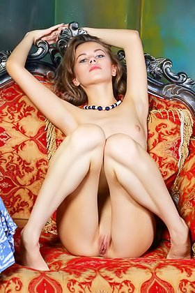 Flat-chested brunette with blue eyes posing naked on the sofa Videos