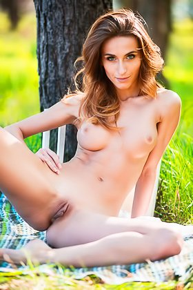 White get-up brunette poses naked next to the tree, in the middle of forest Videos