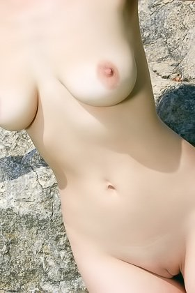 Redhead with a stunning body posing totally naked by the rock Videos