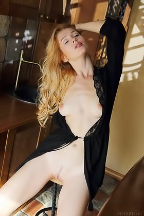 Pasty blonde with a trimmed slit posing seductively in a dimly lit room Videos