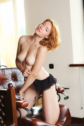 Redheaded girl with perfect breasts shows her curves in a leather chair Videos