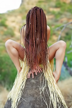 Dreadlocks-sporting tribal goddess posing naked on a penis-shaped rock Videos