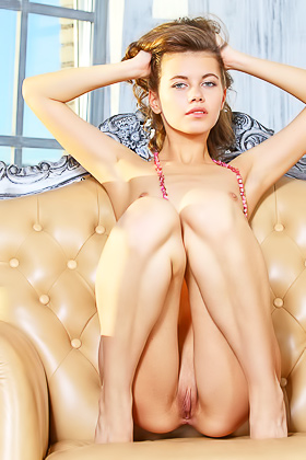 Skinny blue-eyed bombshell poses in a fancy throne-like chair Videos