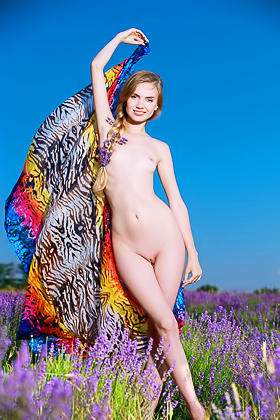 Pale blonde takes off her flowing colorful dress in a flower field Videos