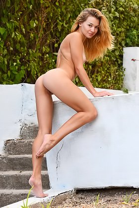 Long-legged natural beauty stripping on the stairs, outdoors Videos