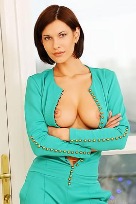 Pantsuit short-haired brunette gets naked to show these massive breasts Videos