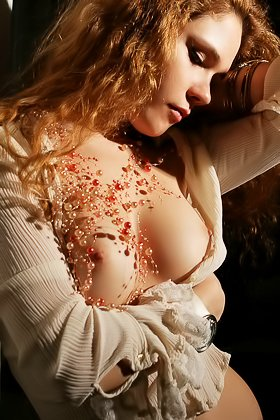 Curly-haired chick with big breasts showing off in a dimly lit room Videos