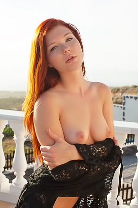 Redhead dressed in black decides to pose totally naked outdoors Videos