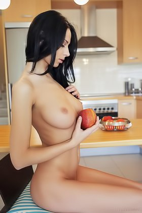 Dark-haired seductress eats an apple while teasing in the kitchen Videos