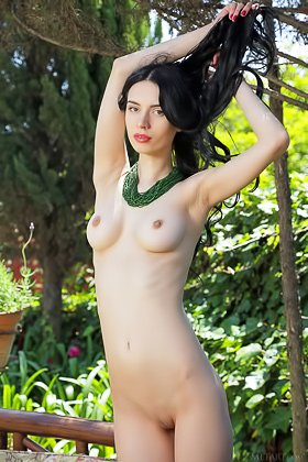 Long-legged raven-haired beauty shows her pussy on a couch, outdoors Videos