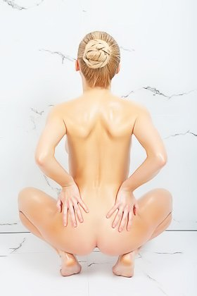 Oily/wet blond-haired beauty striking artsy poses while naked Videos