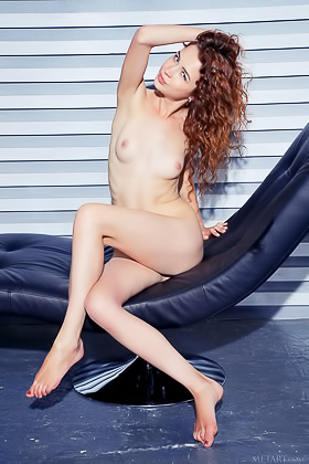 Curly-haired redhead with a smooth slit posing on a recliner Videos