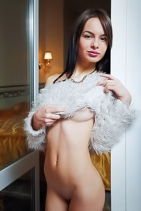 Faux-fur loving brunette showing her pussy on a big fancy bed Videos